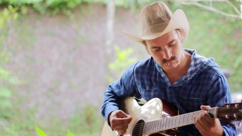 cool caucasian man playing guitar Stock Video Footage