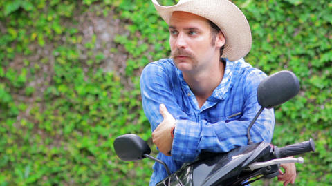 cowboy on motorbike Stock Video Footage