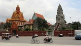 PHNOM PENH - JUNE 2012: Regular Traffic In Front Of Temple stock footage