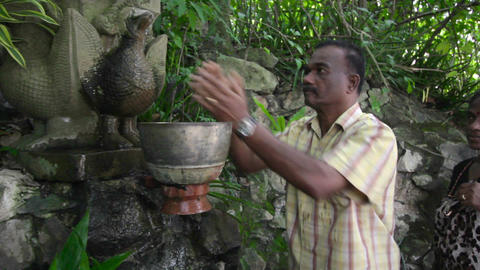 PHNOM PENH - JUNE 2012: indians wash hair with holy water Stock Video Footage
