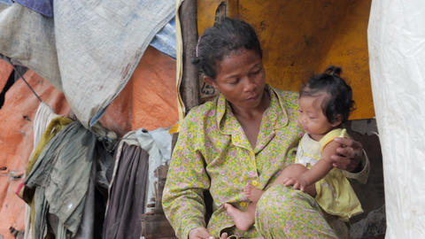 Mother feeding baby in slums Footage