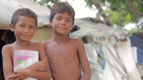 Cambodian boys in slum Stock Video Footage