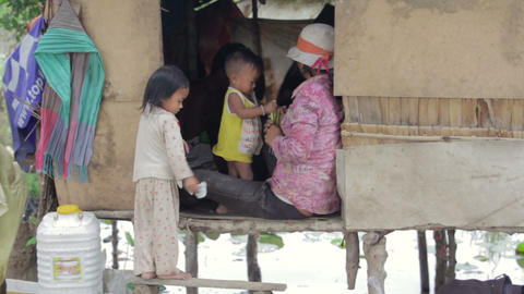 Cambodian family in slum Stock Video Footage