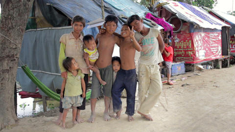 PHNOM PENH SLUMS - JUNE 2012: Friendship in slum Stock Video Footage