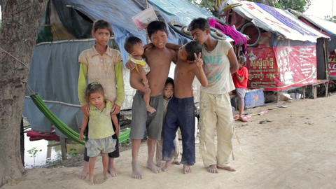 PHNOM PENH SLUMS - JUNE 2012: Friendship in slum Footage