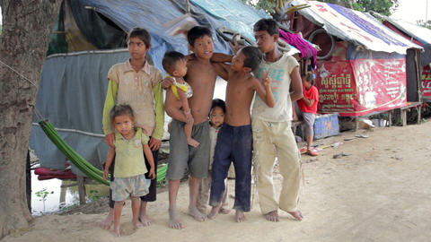PHNOM PENH SLUMS - JUNE 2012: Friendship in slum Stock Video Footage