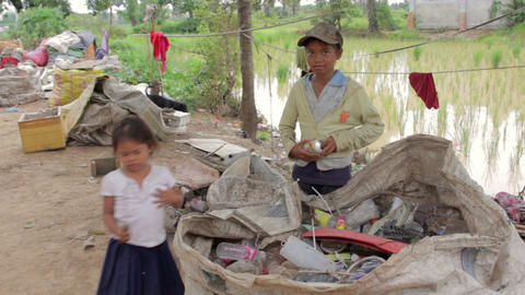 Garbage gatherer childs in cambodia Stock Video Footage
