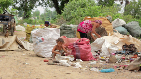 Garbage collector family in asian shanty Stock Video Footage