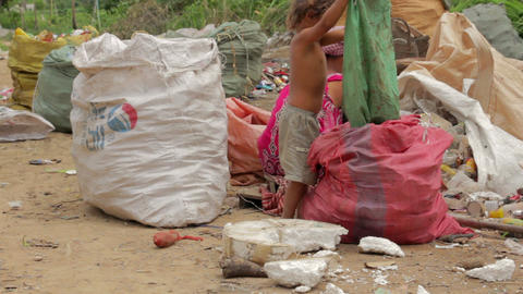 Garbage collector family in asian shanty Footage