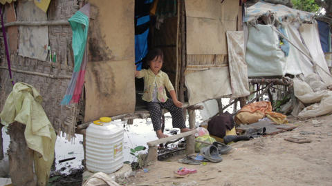 Cambodian kid eating in slums Footage