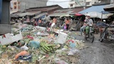 PHNOM PENH - JUNE 2012: local asian market dumping Footage