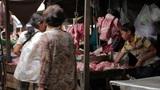 PHNOM PENH - JUNE 2012: local asian market butchers Footage