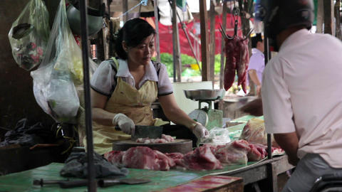 PHNOM PENH - JUNE 2012: local asian market butchers Stock Video Footage