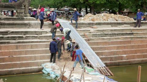 ANGKOR WAT - JUNE 2012: builders makes renovation Stock Video Footage