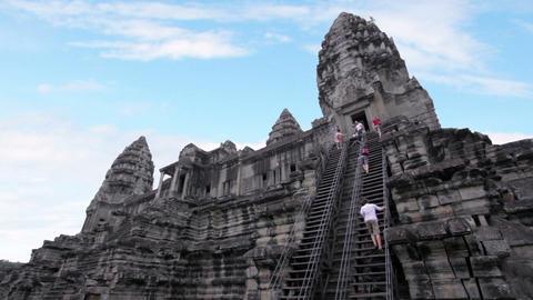 Tourists climbing angkor wat temple Stock Video Footage