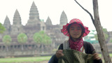 ANGKOR WAT - JUNE 2012: Local Seller Shows Her Products stock footage
