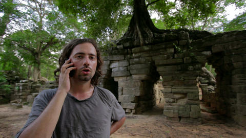 angry phone call in jungle Stock Video Footage