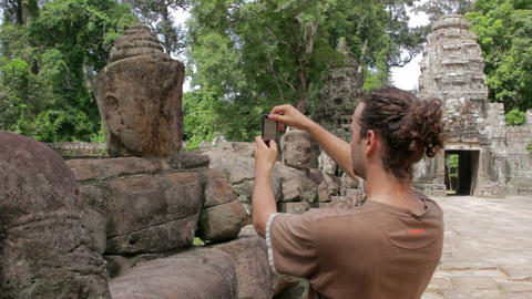 visitor takes picture in angkor Stock Video Footage