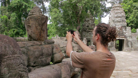 visitor takes picture in angkor Footage