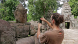 Visitor Takes Picture In Angkor stock footage
