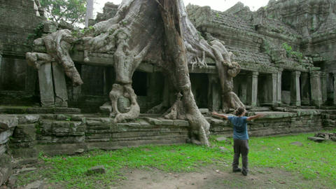 Happy man raised arms in angkor Footage