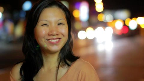 Happy chinese girl outside at night Stock Video Footage
