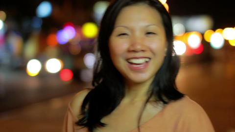 Happy chinese girl outside at night Footage