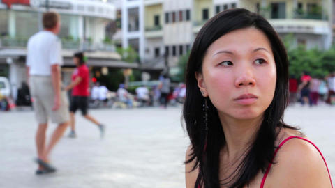 chinese young woman looking for something Stock Video Footage