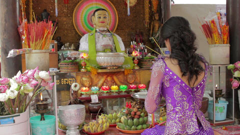 Asian girl praying in temple Stock Video Footage