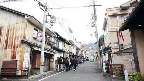 Video of Tourists walk in Kyoto, Japan UNESCO World Heritage city. Walking to ki Footage