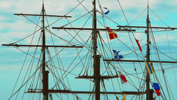 Panning view of masts, rigging and colorful flags of the old frigate against the Footage