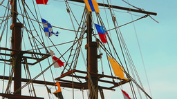 Video - Three-masted frigate ship with colorful flags fluttering in the wind on Footage