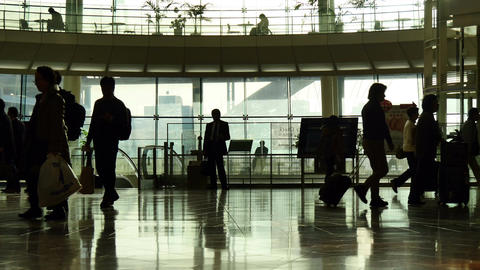 Silhouette of passengers rushing through the airport terminal Footage