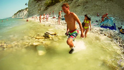 DIVNOMORSKOE. RUSSIA - 02 AUG 2015: A young man jumping in the sea in slow motio Footage