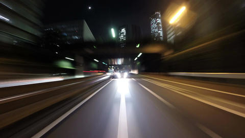 Rear view motion timelapse from a running car through traffic at night Footage