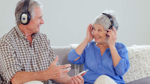 Cute elderly couple listening to music Footage