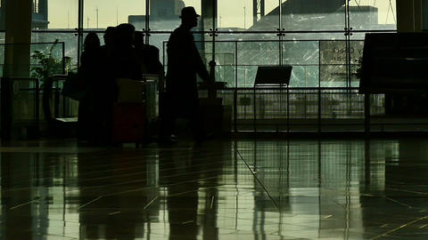 Motion view of an anonymous crowd's silhouette walking through International Air Footage