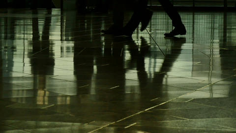 Slow motion view of 2 business men's feet and reflection on the floor ビデオ