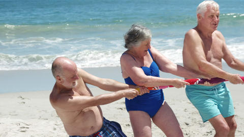 Senior friends playing tug of war Footage
