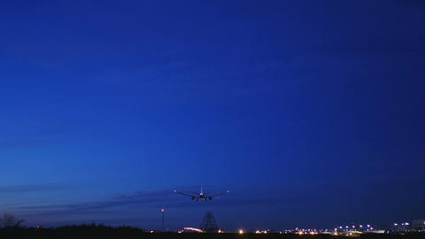 Night view of a modern jet landing at Narita International airport. With sound Footage