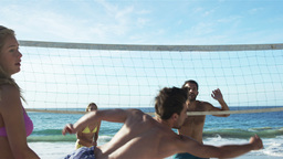 Friends playing beach volleyball Footage