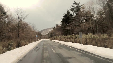 Driver's point of view climbing the Mt.Fuji streets covered in snow Footage