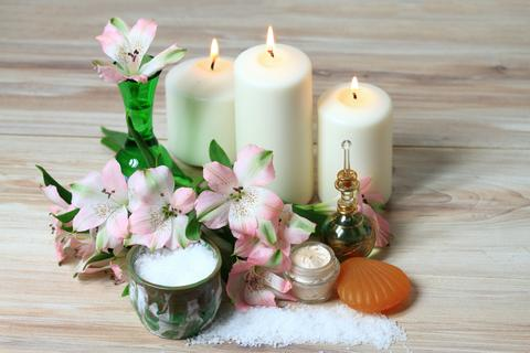 Spa concept with candles and flowers Photo