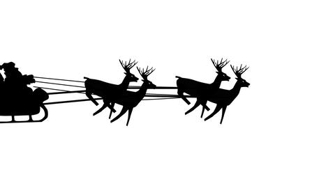 Santa Claus riding in a sleigh with reindeer, rides through the screen CG動画素材