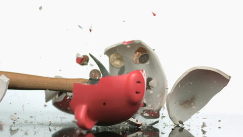 Slow motion smashing piggy bank Footage
