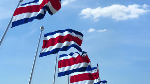 Multiple waving flags of Costa Rica against the blue sky Live Action