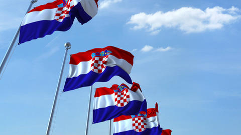 Multiple waving flags of Croatia against the blue sky Footage