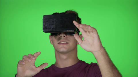Amazed millennial male with VR virtual reality goggles discovering fantastical Footage