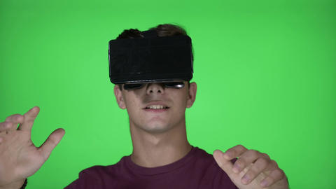 Amazed millennial male with VR virtual reality goggles... 動画素材, ムービー映像素材