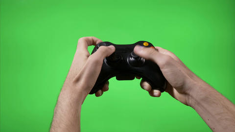 Closeup of gamer hands playing videogame pressing remote controller keys with Footage